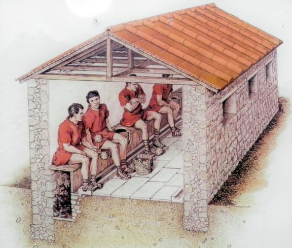 Reconstruction drawing of the Latrine, Barracks, Isca Augusta (UK). A line of timber seats was set over the drain, and in front was a gutter for the soldiers to wash the sponges which served them for lavatory paper.