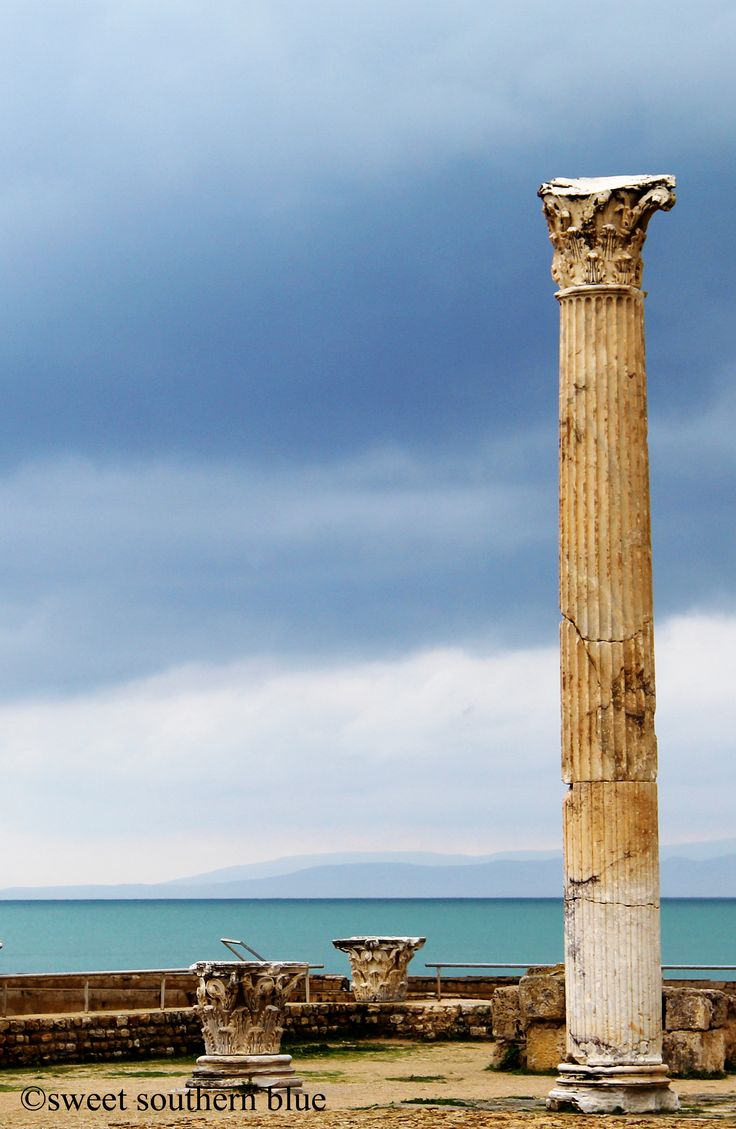 Carthage, Tunisia. Roman Antonin Baths. Originally built from 145 to 165 AD, mostly during the reign of the Roman Emperor Antoninus Pius. Located Parc archéologique des thermes. Looking out over a stormy sea.