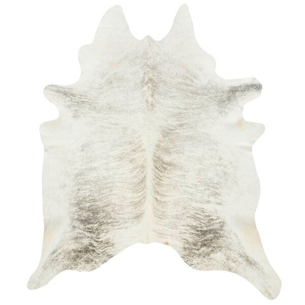 The Best Kept Design Secret Around A Cowhide Rug Never Fails To Give Any Room A Subtly Luxe But Lived In Feel Light Grey Rug Cow Hide Rug Grey Cow Hide