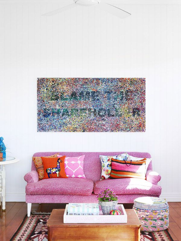 The Brisbane home ofHelen and Chris Bayley and Family // Pink couch from Black & Spiro, Richard Bell painting above couch.  Photo - Toby Scott, production – Lucy Feagins / The Design Files