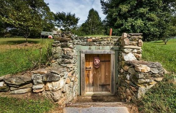 How to use a root cellar to naturally preserve foods, including an explanation of airflow, ethylene gas, and plans showing how to build a root cellar.