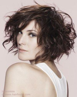 Short hairstyle with layers and scrunched styling.