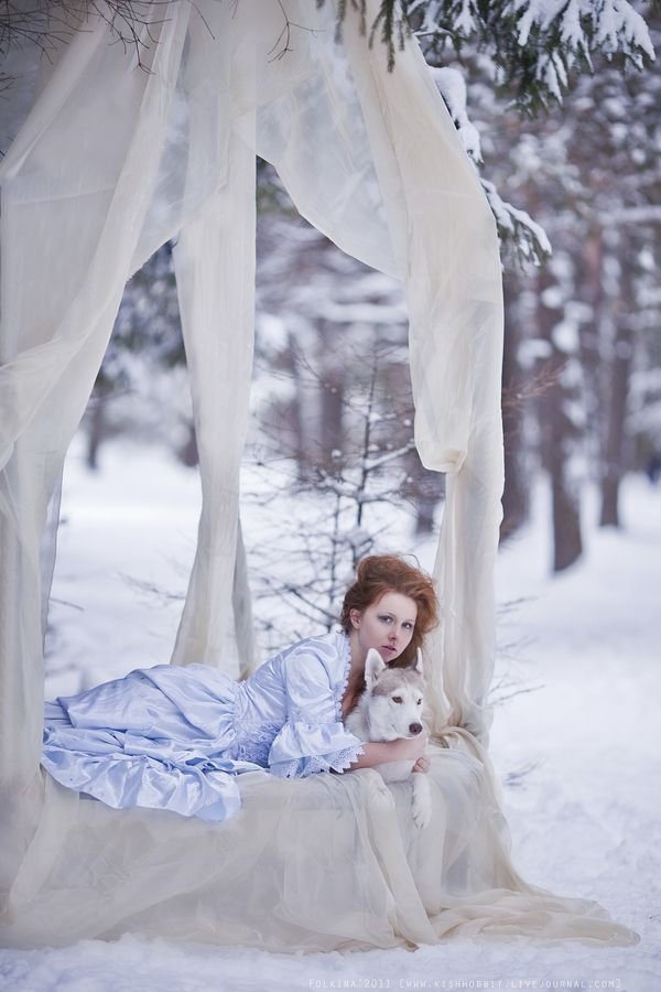 This can only be a snow fairy... who else would hug a wolf in a bed that's out in the middle of a snowy forest? XD