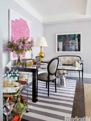 gray walls, pink abstract art, striped rug, bar cart styling, desk inspiration