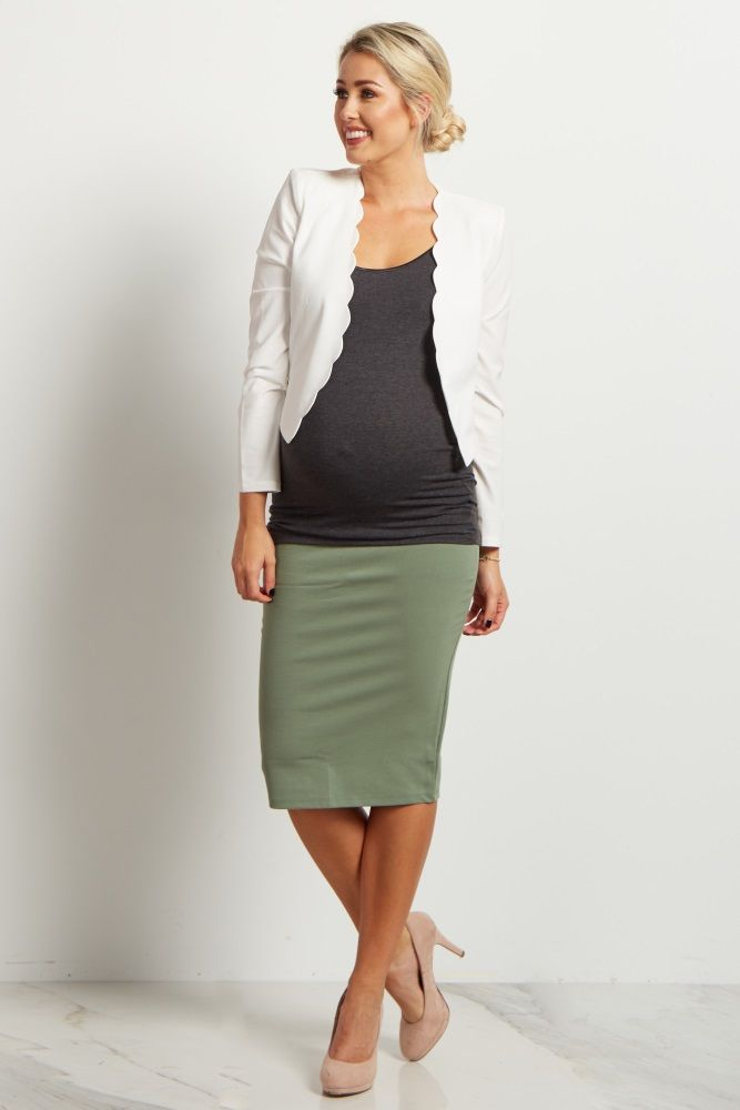 Now you can work it from the office to date night with this fitted maternity skirt. A stretchy material and elastic waistband easily accommodate your growing bump while still looking fabulous. Style this maternity pencil skirt with a blouse or cami and add a blazer for a chic look.