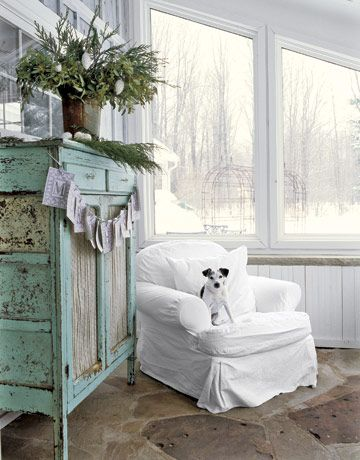 White slipcover chair - love that beautiful pie safe too!