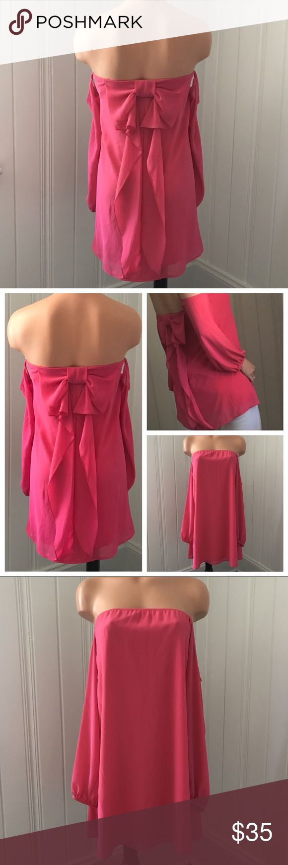 Cold Shoulder Bow Back Chiffon Strapless Blouse S Hot Pink Cold Shoulder Bow Back Chiffon Strapless Blouse S  New with tags. Gorgeous for spring/summer!   Size - Small  Approx Measurements: Bust - 28in -- has an elastic band Length - 25in Sage Tops Blouses