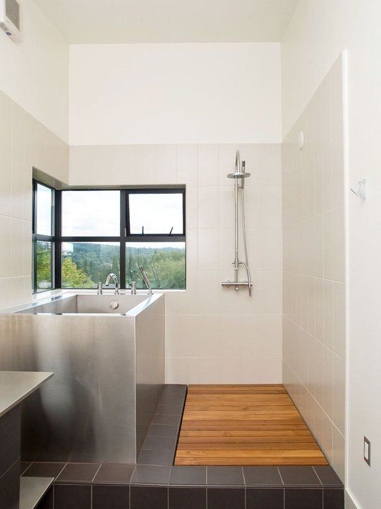 Metal ofuro with shower on the side but what's up the plumbing on the exterior wall?