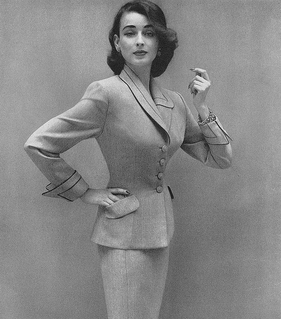 Dorian Leigh wearing a Lilli Ann suit, photo by Richard Avedon, Vogue Sept. 1952