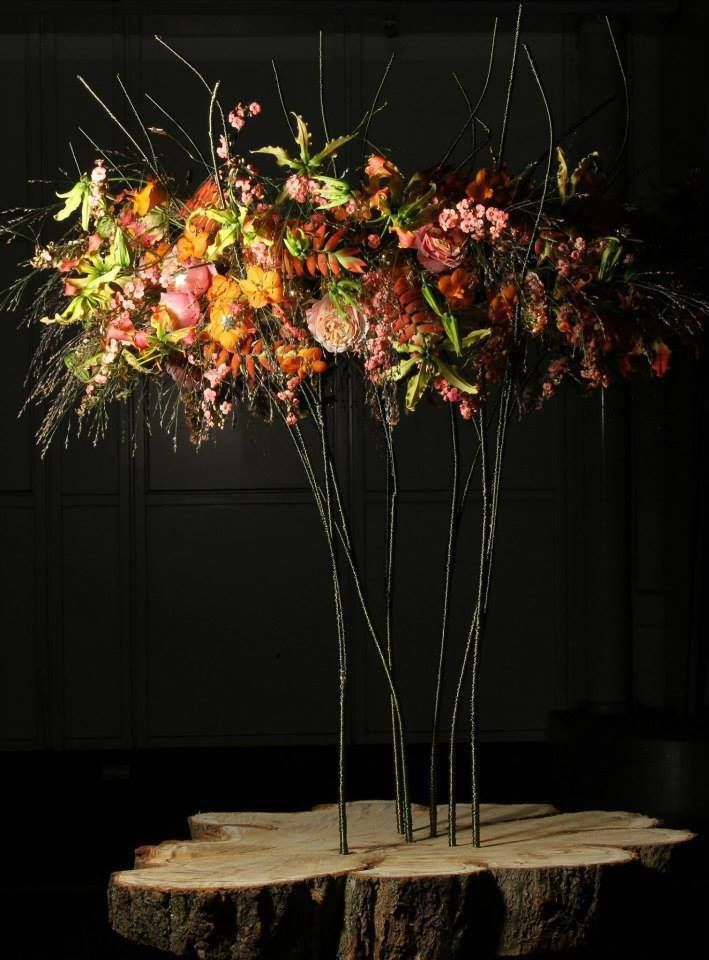 Stunning presentation of elaborate flowers on the most interesting of vessels.