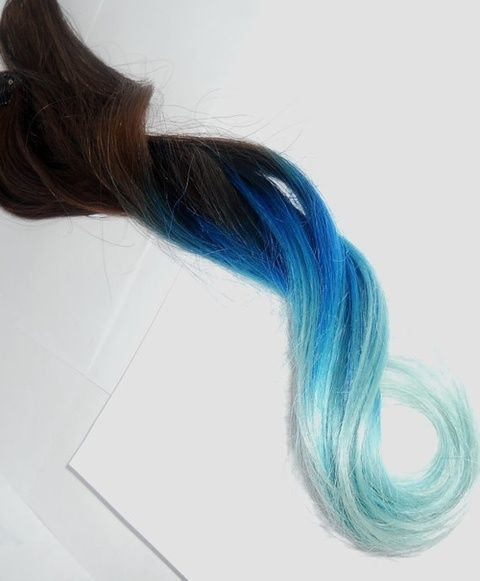 Blue dip dyed brown hair. I really want to do this to my hair this summer!