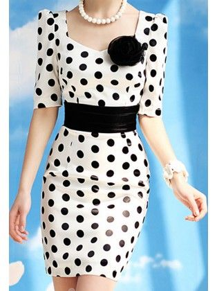 Leatherette white evening dress with black polka dots and a black flower.
