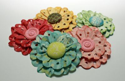 Layered Lace Flowers Pic 1  You need;  thin patterned paper  border punch  flower centers  paper crimper  ink(optional)  circle punch (optional)  glue  cardstock scraps  scissors  paper trimmer