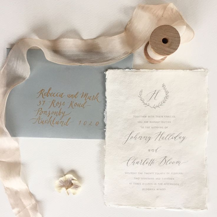 Classic and elegant calligraphy invitations with leaf and berry wreath, finished with a beautiful calligraphy monogram.