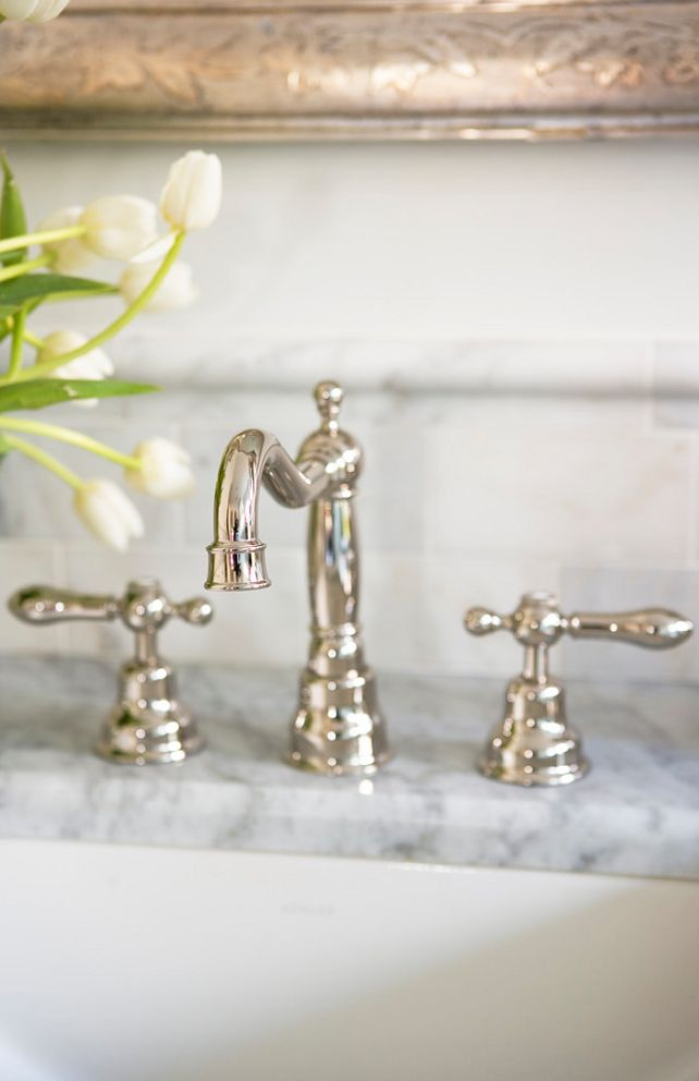 The bathroom faucet is by Rohl (AC107 LM Polished Nickel).