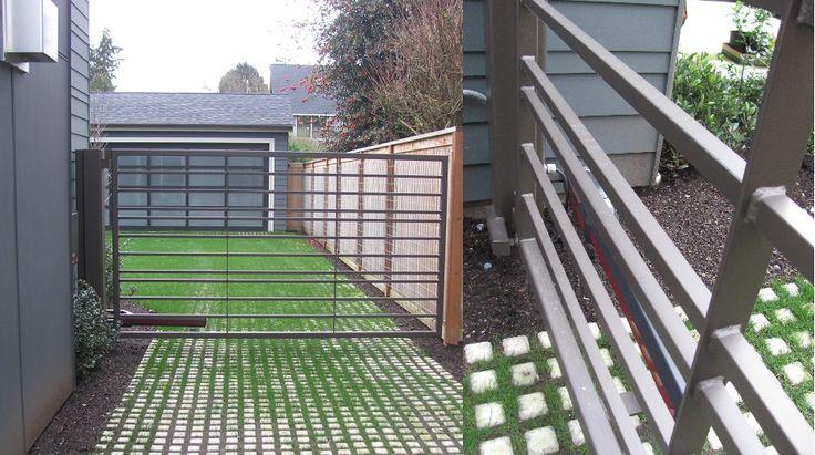 Single swing gate with custom flat bar vertical pickets