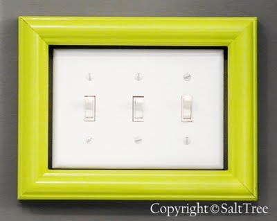 Recycle old picture frame with some fresh paint to dress up a Iight switch.