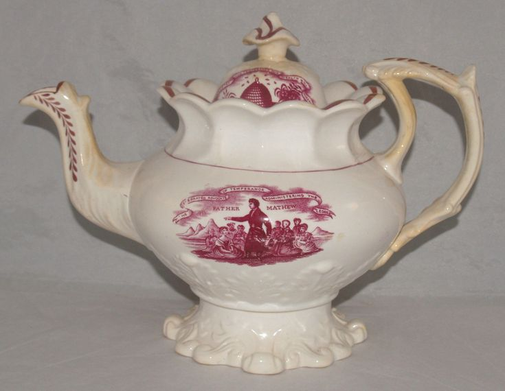 Unattrributed English Round with intricate moulded base,high curving handle with spurs,moulded spout with one spur,lobed collar with squat shaped finial.Puce transfer printed with Father Mathew Temperance Movement 8 ins high c.1835
