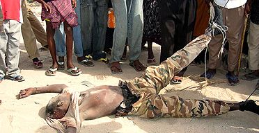 the battle of mogadishu | The body of a Somali soldier killed in heavy fighting in Mogadishu is ...