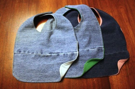 Turn your old jeans into bibs for your child.  Stain resistant, water resistant and durable.  We've used ours for years in my daycare, and they still look great. (happy hooligans)
