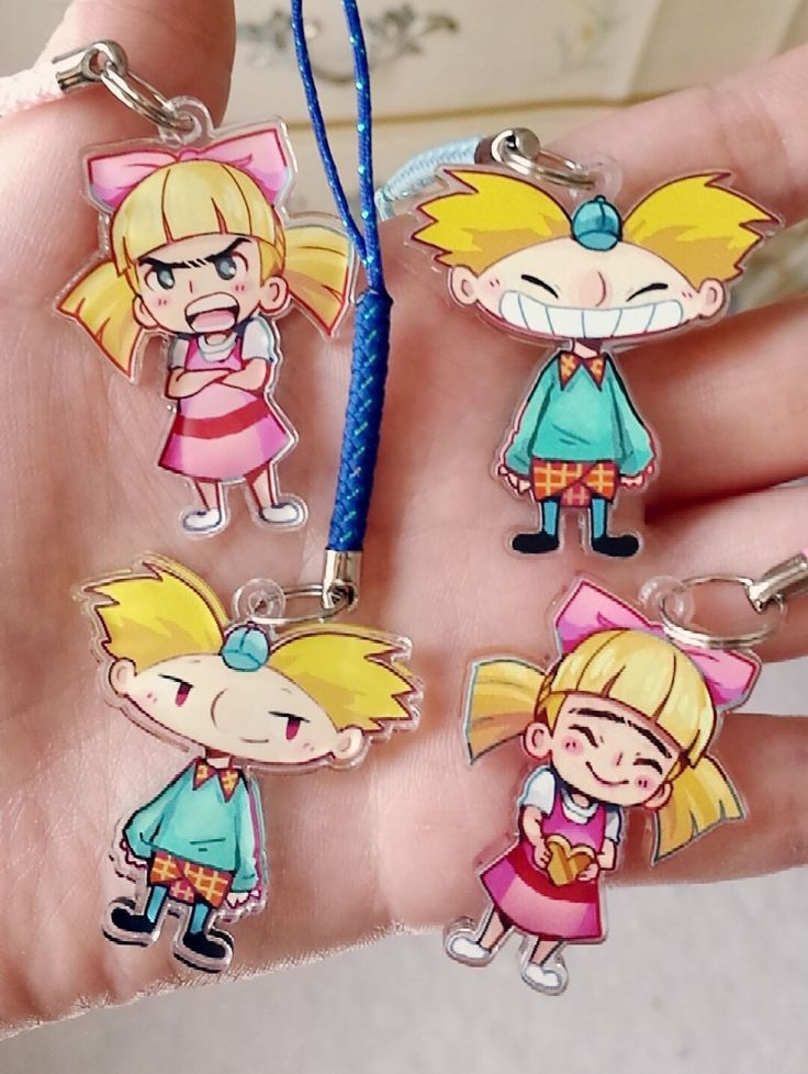 """Double-sided 1.5"""" charm of Arnold and Helga from Hey Arnold! Printed on durable, waterproof clear acrylic *lanyard color may vary from photo"""