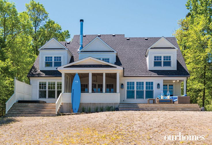 "Water-side, the home has three distinct outdoor spaces: a hot tub deck outside the master suite, a screened porch and a seating deck with access to the generous beach area.     See more of this home in ""Cape Cod Style Home on the Shores of Georgian Bay"" from OUR HOMES Southern Georgian Bay, Summer 2017 http://www.ourhomes.ca/articles/build/article/cape-cod-style-home-on-the-shores-of-georgian-bay"