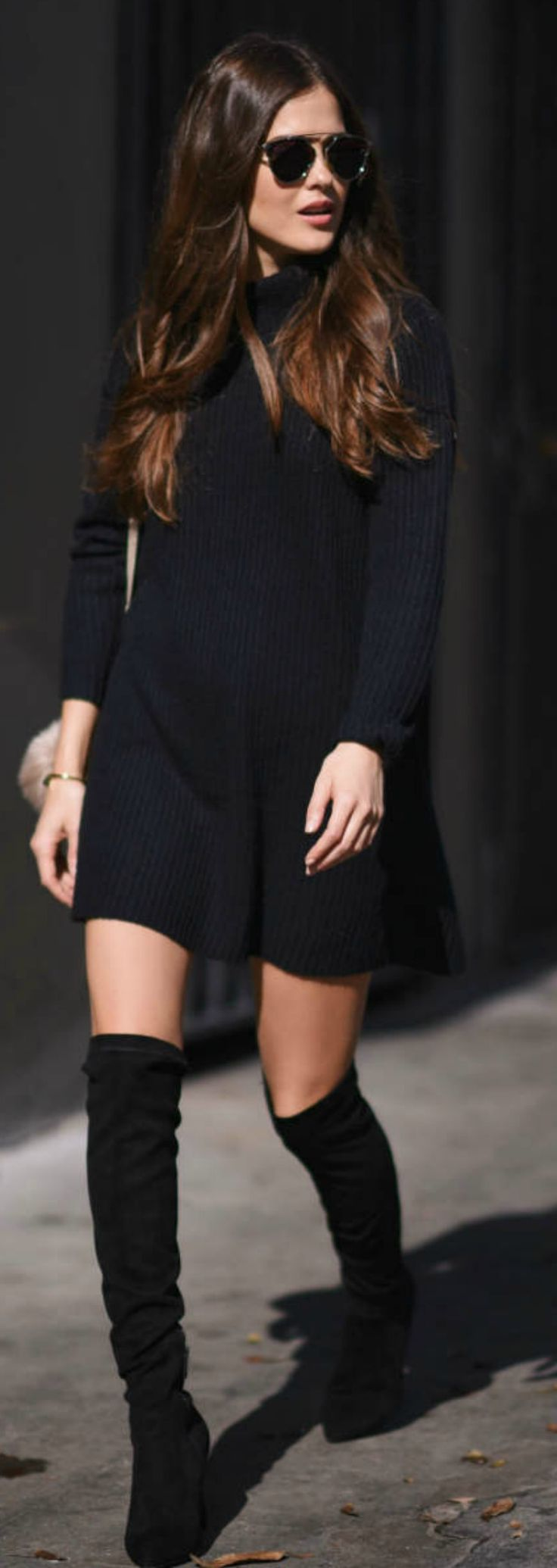 Paola Alberdi wears thigh high boots with a minimalistic black sweater dress, creating a casual, elegant style which is perfect for any occasion!  Dress: Glamorous, Boots: Joie, Handbag: Chloe Faye