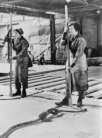 St.Helens Pilkington Glass? Female workers hold a sheet of glass in position in a Lancashire factory during the First World War. 1914 Photographer Lewis G P