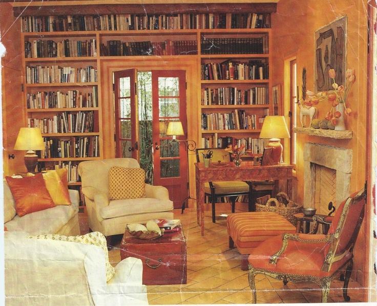 love the orange bookshelves in this room