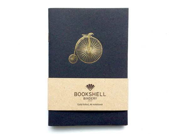 Retro A6 pocket notebook with goid foiled penny farthing on the front and blank pages inside. A great gift for your brother, boyfriend or husband. For under £5 it makes a good stocking filler idea and a stylish mens gift!  • Black cover made from 280gsm matt card • 40 blank internal pages