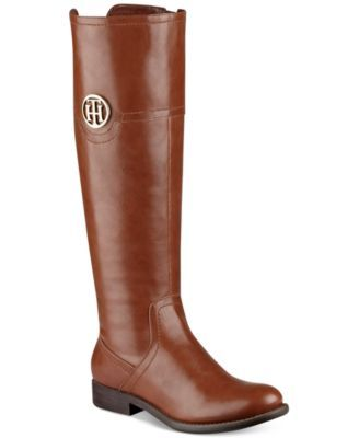 The always-chic riding boot silhouette gets a signature Tommy Hilfiger update with a medallion logo on the shaft of the Silvana boots. | Manmade upper; manmade sole | Imported | Round closed-toe tall