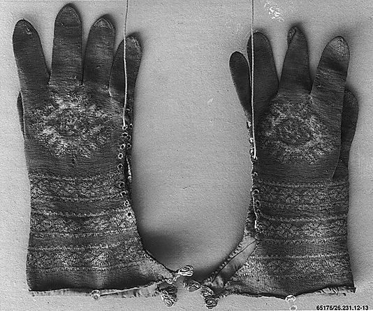 Just love the lacing/eyelets all the way up the side  Knitted liturgical Gloves    Date:      16th century  Culture:      Italian  Medium:      Silk and metal thread  Dimensions:      L. 11 1/2 x W. 6 inches 29.2 x 15.2 cm  Classification:      Textiles-Laces-Knitted  Credit Line:      Rogers Fund, 1926  Accession Number:      26.231.12-13