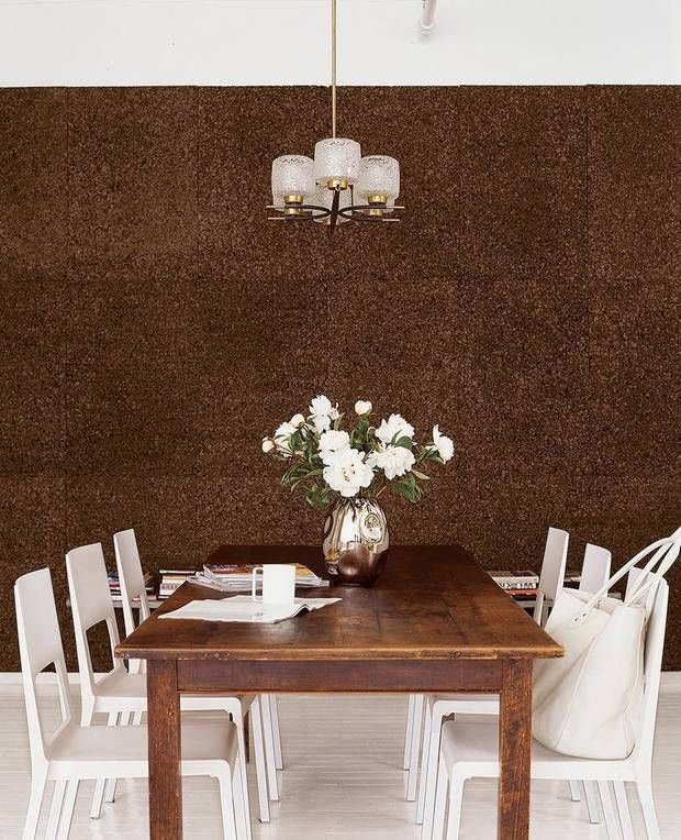 cork walls dining room with acrylic chairs and cork wall