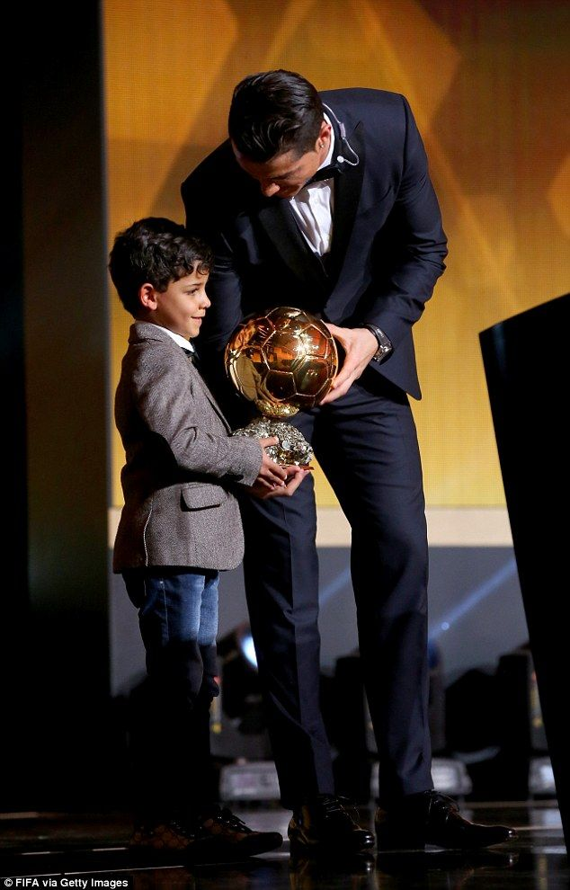 Ronaldo hands over the Ballon d'Or to his son, Cristiano Ronaldo Jr, on the podium in Zuri...