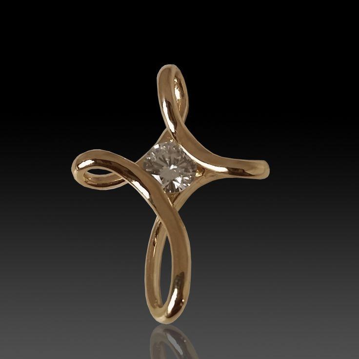 14 karat yellow gold free from cross pendant with diamond