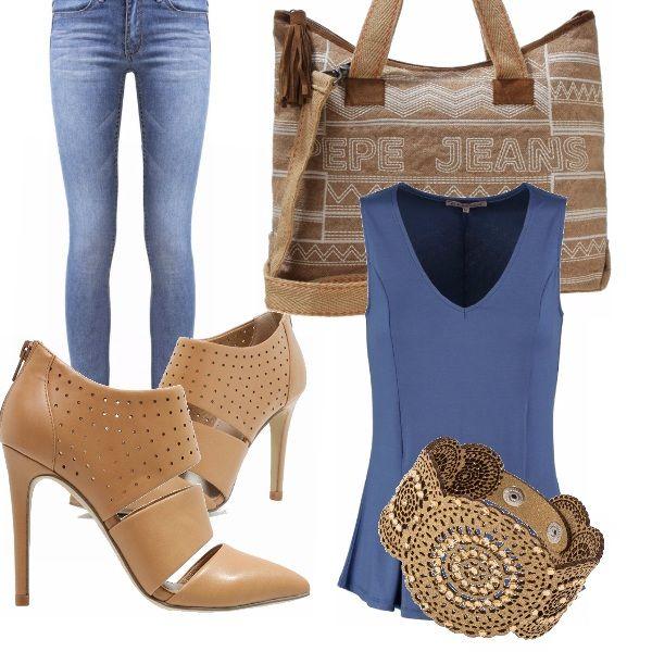 Per questo outfit in blu ho scelto gli accessori color camel, che rendono…