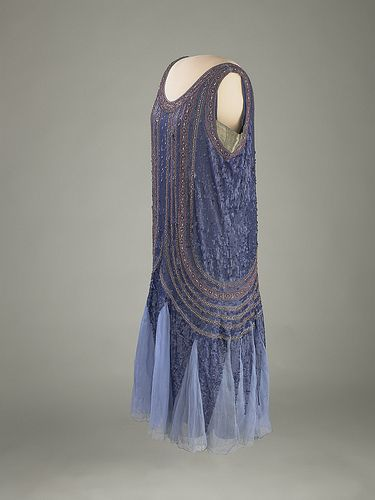 Blue satin flapper-style evening gown trimmed with dark-blue sequins and gold glass beads. Grace Coolidge gave the dress to her White House maid, Maggie Rogers. It was likely shortened to be worn by Maggie's daughter Lillian.
