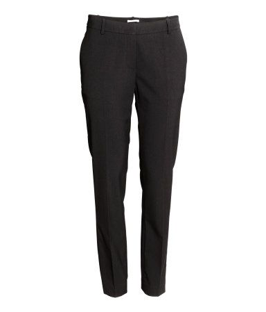 Suit pants in woven stretch fabric. Side pockets, regular waist with concealed hook-and-eye fastener, and welt back pocket. Tapered legs with creases.