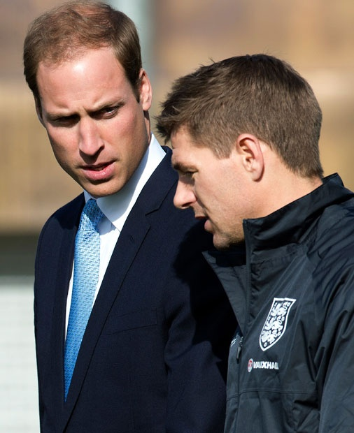 Prince William speaks with England and Liverpool footballer Steven Gerrard