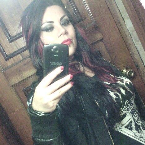 Black metal girl. Black & red hair.