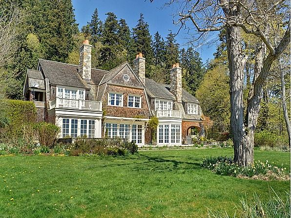 This home owns the open kitchen with the stone fireplaces; on Bainbridge Island (one of my fave places).