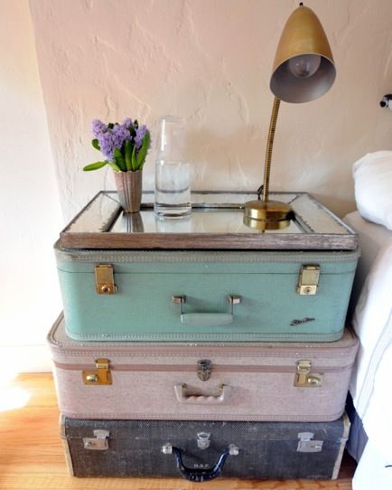 Bedside table with stacked vintage suitcases- love this for a nightstand in our soon to be new bedroom!