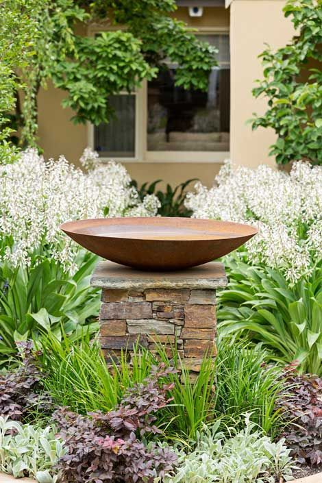 An alternative central feature could be a bird bath on a plinth.