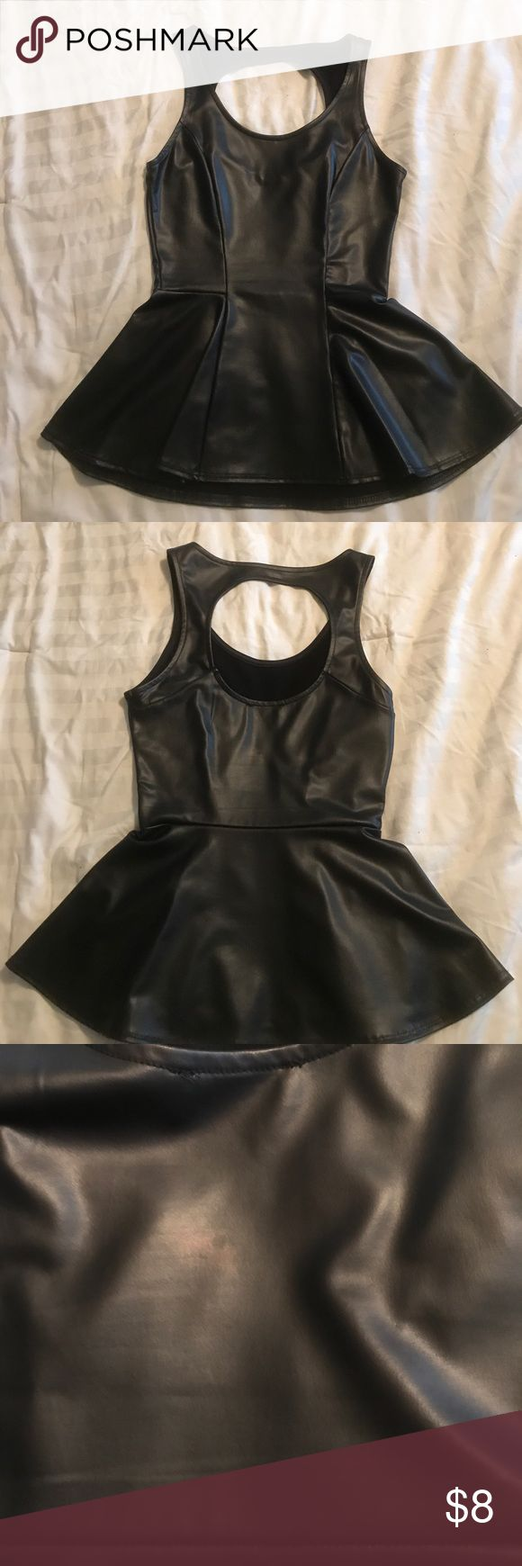 Kirra faux leather peplum top! Good condition! Kirra faux learn peplum top! Slight discoloration on the back when under bright light but is not very visible otherwise. Only worn once! Size: XS Kirra Tops Tank Tops