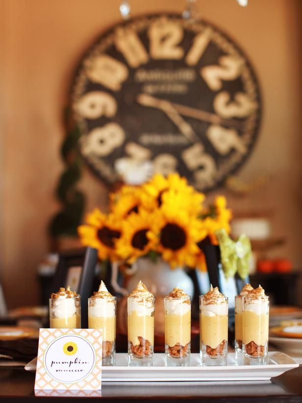 Set up a dessert buffet. This is Pumpkin Mousse Parfait. See more gorgeous dessert displays (and get recipes): www.hgtv.com/entertaining/sunflower-themed-thanksgiving-dessert-buffet/pictures/page-6.html?soc=pinterest