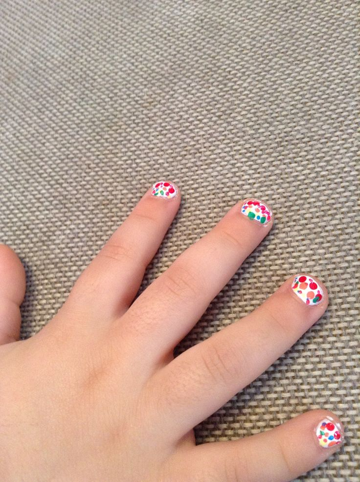 I did my little sisters nails! Rainbow polka dots! I again don't remember the name!