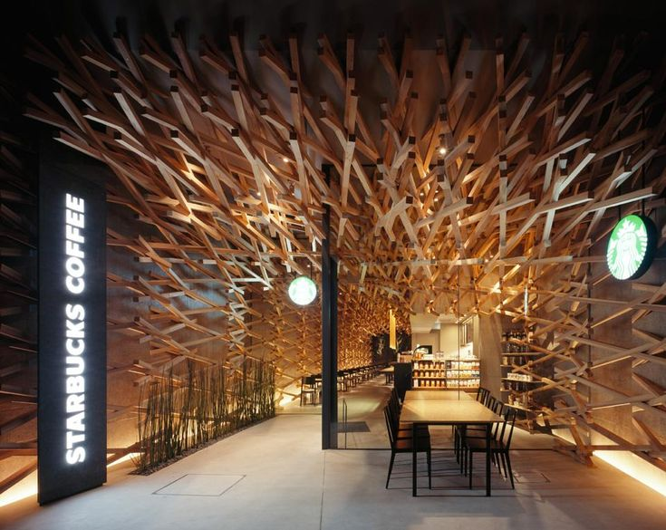 Kengo Kuma for Starbucks—  The Japanese architect's latest project is a fluid, cavernous space, diagonally weaving 2,000 wood poles to create a striking effect