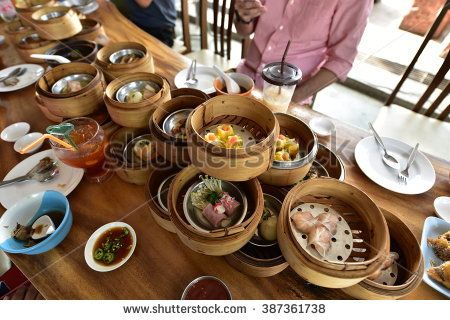 People Stock Images , People Pictures , person photo , - PHUKET, THAILAND - FEB 13,2016: yumcha, various dim sum in bamboo steamer in chinese restaurant in PHUKET, THAILAND