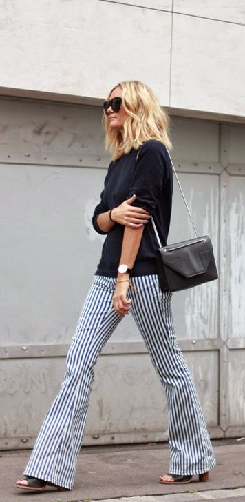 Adenorah is wearing trousers from Revolve Clothing, shoes from Whistles, bag from Saint Laurent, sunglasses from Céline and the top is from Uniqlo