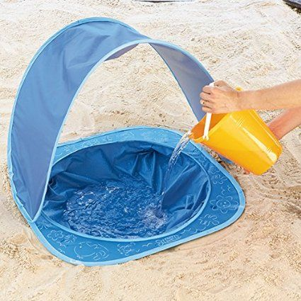 Amazon early years. Shade baby toddler beach pool dig a small hole in sand pace pool in hole fill with a bucket. Full of water and play great idea with sunshade